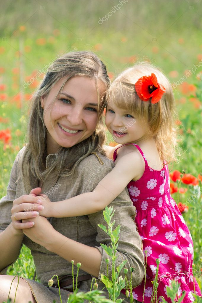 Happy mother and daughter in poppy field — Stock Photo #11011769
