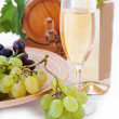 Stock Photo: White wine bottle, glass and cask with grapes