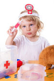 Little girl playing as doctor — Stock Photo