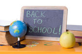 Back to school word on board, books and globe — Stock Photo