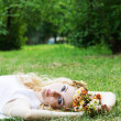 Romantic woman lying down on grass — 图库照片