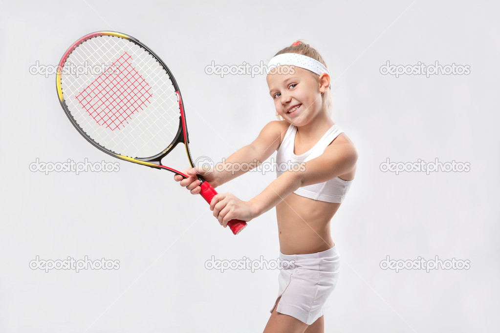 Little girl in sportswear with tennis racket, smile  Stock Photo #11765493