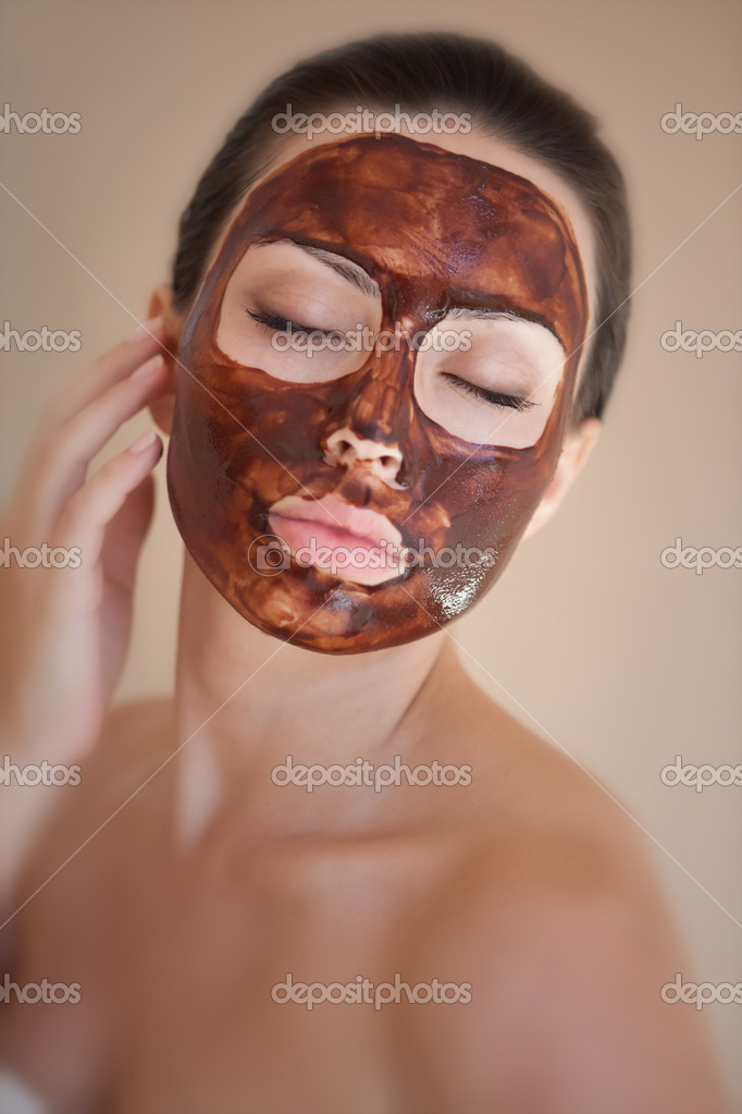 Beautiful girl with a chocolate mask on his face  Stock Photo #12275980