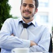 Young businessman on coffee break - Stock Photo