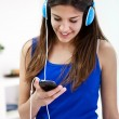 Stock Photo: Teenager girl listening music