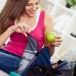 Teen girl preparing for school. - Stock Photo