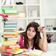 Unhappy student with big stack of books — Stockfoto