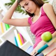 Upset girl learning at home — Stockfoto