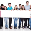 Group of happy holding banner, isolated — Stock Photo