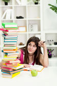 Unhappy student with big stack of books — Stock Photo