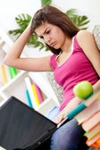 Upset girl learning at home — Stock Photo