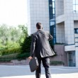 Business man leaving after a working day - Stock Photo