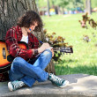 Young composer in park — Stock Photo