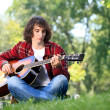 Musician in park — Stock Photo