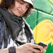 Modern guy with mobile phone — Stockfoto