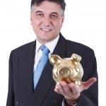 Businessman holding a piggy bank — Stock Photo #10883765
