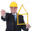 Senior architect holding keys of new house - Stock Photo