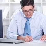 Senior businessman working in office — Stock Photo