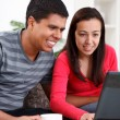 Couple Looking at Laptop — Stock Photo #10883939