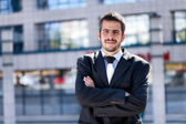 Businessman in front of an office — Stock Photo