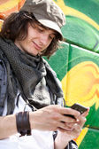 Modern guy with mobile phone — Stock Photo