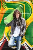 Trendy boy with skateboard — Stock Photo