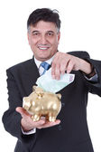 Businessman with piggy bank and money — Stock Photo