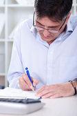 Business man writing note — Stock Photo