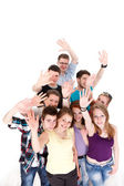 Group of smiling friends waving their arms — Stock Photo