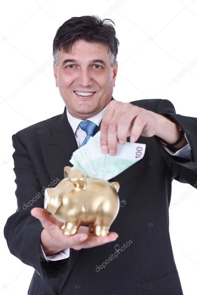 Senior businessman putting money in piggy bank , isolated on white background — Stock Photo #10883768