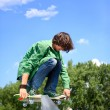 Stock Photo: Young skateboarder skating
