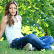 Girl relaxing in park — Stock Photo #11467597