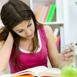 Tired teenager girl learning — Stock Photo