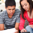Lifestyle - young couple doing their accounting — Stock Photo