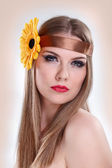 Beauty make up woman with flower in hair — Stock Photo