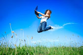 Jumping woman with laptop — Stock Photo