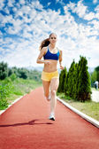 Runner - woman running — Stock Photo