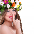 Spring fairy with finger on lips — Stock Photo