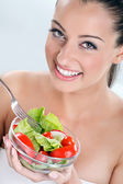 Woman in enjoys eating a salad — Stock Photo