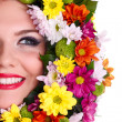 Woman face in flower wreath — Stock Photo