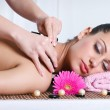 Young lady receiving back massage at spa center — Stock Photo
