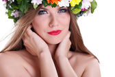 Beautiful woman with flower in hair — Stock Photo