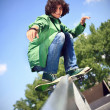Royalty-Free Stock Photo: Boy skateboarding at a park