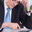Stock Photo: Worried businessmcalculating