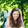 Girl relaxing and enjoying on grass — Stock Photo