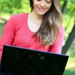 Stock Photo: Woman with laptop, outdoor