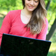 Woman with laptop, outdoor — Stock Photo