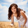 Stock Photo: Smiling woman in wheat field