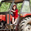 Woman on tractor — Stock Photo #11926768