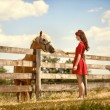 Woman on the farm with her horse — Stock Photo #11926779